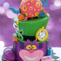 Alice In Wonderland Birthday  100% edible - even the wee little chain links on the pocket watch! Tea pot and hat are vanilla bean and raspberry and the cat is one of my...