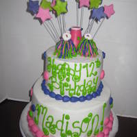 Cheerleading Cake lime green pink purple cheerleading cake with fondant megaphone and bc pom poms