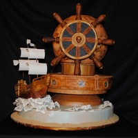 Around The World Pirate Style! This is my competition cake for this years fair. The only thing on this cake from my original design plan is the ship! LOL I started into...