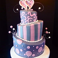 "Eggplant And Mauve Bridal Shower Cake This is a three tiered (12"", 9"", 6"") topsy turvy cake. Each tier is three layers of cake. Due to the amt of people invited,..."