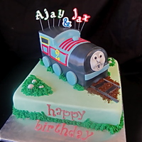 "Thomas The Train This is a 12"" square (marble) cake with a (chocolate) Tomas the Train on the top. Thomas was made from the Wilton Train Pan. The cake..."