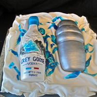 "Grey Goose Vodka And Shaker This is a 12"" square cake that is coated in Sugarshack buttercream and covered in Fondx fondant. The vodka bottle and shaker are..."