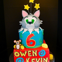"Kevin And Owen's Tom And Jerry Cake This cake is made from a 9"", 6"" and ball pan . It's coated in Sugar shack buttercream and covered in Fondx Fondant. All of..."