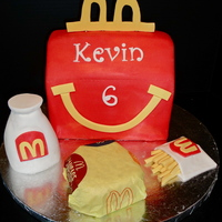 Kevin's Happy Meal Cake My son was turning 6 yrs old and wanted one of his favorite things for a cake... Mc Donalds Happy Meal. The cake is the red Happy Meal...