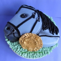 2D Horse Head Cake   2D horse head cake. Vanilla cake with strawberry jam and Swiss meringue butter cream.