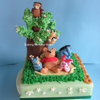 Winnie The Pooh. I made this as a 18th birthday cake, the recipient loves Winnie the pooh! Chocolate cake soaked with raspberry syrup, filled with raspberry...