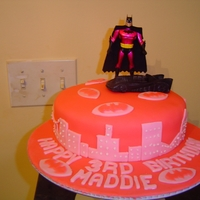 Pink Batman White cake colored pink and covered with pink fondant.