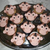 Monkey Cupcakes - Baby Shower   Monkey cupcake toppers made out of fondant
