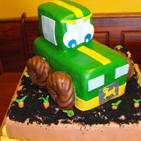 John Deere Tractor Cake This is a John Deere tractor cake that I made for a 1 year old boy. The tractor is all cake except the wheels which are chocolate covered...