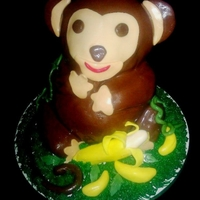 Monkey Banana cake with banana buttercream. I used the wilton Teddy Bear pan for the body, cut off his ears and legs. I then restructured the legs...