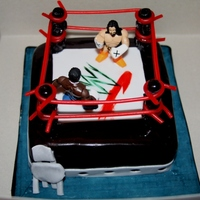 "Wwe Wrestling Cake Plastic figures and everything else is fondant. I used a 6"" sqaure pan."