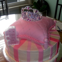 Princess Cake Chocolate cake w/ chocolate mousse, BC and fondant decorations. Pillow yellow cake w/ jelly filling cover with fondant.