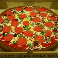 "Pizza Cake 16"" round 1 layer cake. Sauce is petit four icing dyed red. cheese is a block on fondant grated onto ""pizza"". Fondant black..."