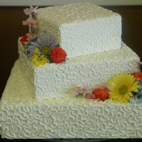 "Offset Square With Cornelli Lace   3 tier offset square. sizes 8"", 12"", 16"".cornelli lace design and artificial wild flowers"