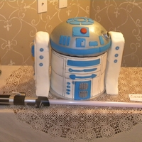 R2-D2 Grooms Cake R2-D2 body make of cake covered in fondant, side pieces are styrofoam covered in fondant