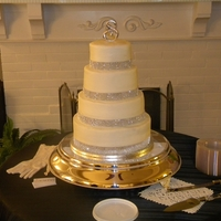 Sparkle Wedding Cake   round tiered wedding cake, multiple flavors, buttercream exterior with jeweled rope border around each tier