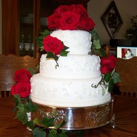 Wedding Cake 3 tiered stacked wedding cake covered in mmf with real flowers.