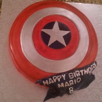 Captain America Shield   This is a the Captain America Shield cake, chocolate cake hand painted.