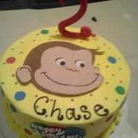 Curious George Topper Made Of Fondant As Well As Other Edible Decorations Curious George topper made of fondant as well as other edible decorations.