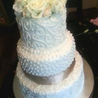 Buttercream Wedding Cakes *Wedding Cake..3 tiered covered in buttercream and accepted by fresh flowers
