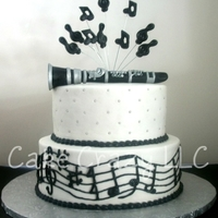 Clarinet Customer ordered for a clarinet performance. Cake is covered in BC. Clarinet and music notes on wires done with fondant.