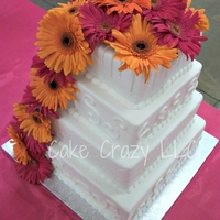 Gerber Daisy Wedding All B.C. with scrolls and quilting with white sugar pearls and fresh gerber daisies.