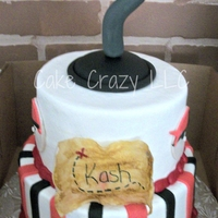 Pirate Theme 2 tiered cake for 2 brothers. Covered in BC with fondant stripes, pirates, and hook. Maps are rice paper.