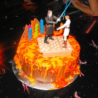 Battle Of Mustafar White chocolate ganche death by chocolate cake. I had mini glow sticks under the platform so it glowed. It was neat but didn't show up...