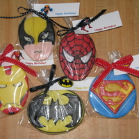 Super Heroes Super Hero NFSC covered with fondant and RI details. Made them for favors for a little boys birthday party.