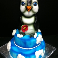 Penguin On Ice Penguin is a rice crispy and fondant sculpture sitting on the cake