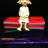 Harry Potter's Dobby The House Elf On A Wand Box This for my friend that's a huge Harry Potter fan. Dobby and the wand are fondant and the box and lid are cake