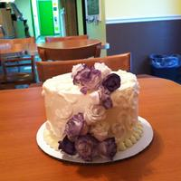 Summer Wedding Cupcake Tower Client had a color scheme of creme brown and a touch of purple..