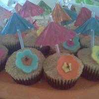 Hawaiin Luau Cupcakes These are cupcakes I made to go with a Hawaiian Luau theme cake. Buttercream frosting covered in graham cracker crumbs. flowers are made of...