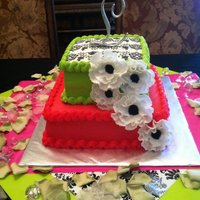 Liz's Bridal Shower All buttercream with edible Damask design paper on top....flowers are fondant.
