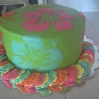 Hawaiaan Luau Cake Buttercream frosting with fondant flowers that I made a stencil for and cut out by hand. The flower lei is made of fondant as well to match...