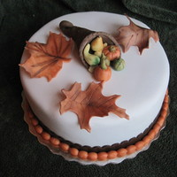 Cornucopia Cake Pumpkin cake with all fondant covering and decorations. I loved the end result of this.