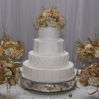 Ivory Wedding Cake Ivory color buttercream frosting with fondant accents dusted with pearl dust