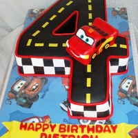 Lightening Mcqueen 4 is all cake and Lightening McQueen is made out of rice cereal treats. Cake board is fabric.