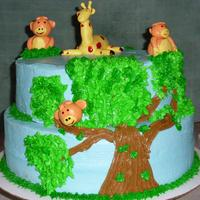 3Monkeys In A Tree  1st birthday cake for quads (3boys and a girl) who their mother refers to as the monkeys and sister is the giraffe. BC icing and MMF...