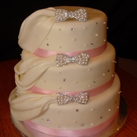 Pink And White Wedding   Wedding cake for a friend with draping, white dragees, and hair clips that I took the back off of and used as bling