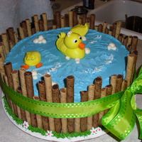 "Duck Pond   12"" tiered cake with BC icing, surrounded by pirouette cookies. MMF duckies"