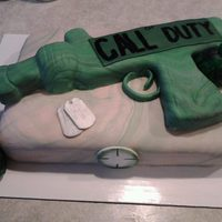 Call Of Duty Birthday  chocolate cake covered in MMF, gun made out of RCT covered in chocolate and MMF, hand grenades made out of MMF and painted with food...