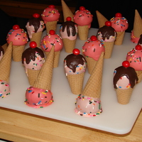 Ice Cream Cone Cake Pops Ice cream cone cake pops Joe helped me make for his coworkers. He insisted on using the pointed cones and so he had to make the stand they...