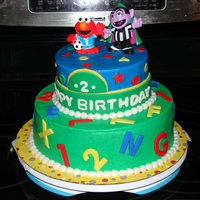 Sesame Street Cake Sesame Street themed cake for a little boy turning 2 at a local shelter. the characters on top are toys he can keep when the cake is gone...
