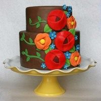 Teacher's Birthday Cake This is a cake that I made for my daughter's first grade teacher. It is a nod to the fanciful flowers of Mary Engelbreit. The fondant...