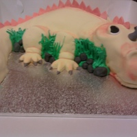 Cute Dino this cake was made for a friends nephew its vanilla with fruit and cream cheese filling chocolate ganache and fondant icing.