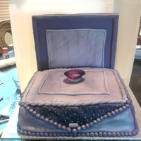 Open Ring Box this was an engagement cake for a client chocolate mud with chocolate ganache filling.