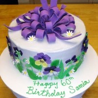 Pansy Birthday Cake Buttercream cake with fondant/gumpaste pansies, daisies, and bow.