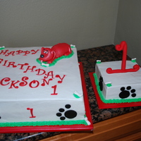 Clifford The Big Red Dog  Clifford 1st Birthday. White cake with Strawberry Mist filling. Covered in Buttercream. Dog made of modeling chocolate and covered in...