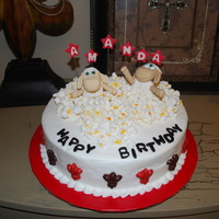 Popcorn & Sheep  This cake was all of the birthday girls favorite things - Popcorn, Sheep, Fleur de Lis, college colors and of course Double Fudge Chocolate...